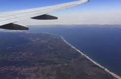 Aerial view of an airplane wing over California coast Stock Photography