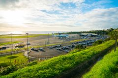 Aerial view on the airport with few planes. Parked by the terminal. Airport is located by the Atlantic ocean during Sunset time Stock Photography