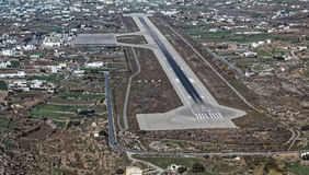 Aerial view of the airport in Mykonos island, Greece. Aerial view of the airport and landing runway in Mykonos island, Greece stock photo