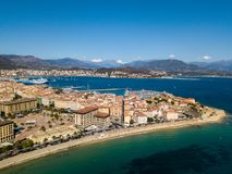 Aerial view of Ajaccio, Corsica, France. The harbor area and city center seen from the sea. Harbor boats and houses Royalty Free Stock Photos