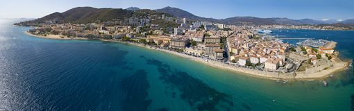 Aerial view of Ajaccio, Corsica, France. The harbor area and city center seen from the sea. Harbor boats and houses Royalty Free Stock Photography