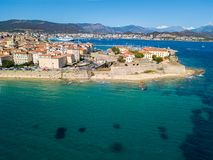 Aerial view of Ajaccio, Corsica, France. The harbor area and city center seen from the sea. Harbor boats and houses Royalty Free Stock Photo