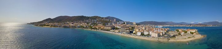 Aerial view of Ajaccio, Corsica, France. The harbor area and city center seen from the sea. Harbor boats and houses Royalty Free Stock Images