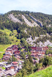 Aerial view of Albertville. In the French Alps. Houses are surrounded by meadows and mountains. It is a vertical picture on a sunny day Stock Images