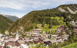 Aerial view of Albertville. In the French Alps. Houses are surrounded by meadows. You can see the church on a sunny day Stock Image