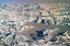 Aerial view of Allpes. Aerial winter view of mountain. Alps between Italy and Switzerland Royalty Free Stock Image
