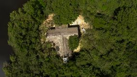 Aerial view of alone hut in the middle of a jungle rain forest royalty free stock photography