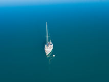 Aerial view of alone yacht sailling on azure water. Beautiful aerial view of alone yacht sailling on azure water Stock Photo