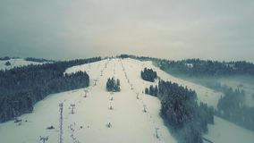 Aerial view of alpine skiing slopes and ski lifts in winter. The Tatra mountains. Aerial view of alpine skiing slopes and ski lifts in winter stock footage