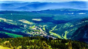 Aerial view of the alpine village of Sun Peaks in the Shuswap Highlands in British Columbia, Canada. Aerial view of the alpine village of Sun Peaks from a hiking stock images