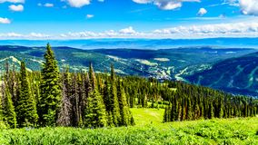 Aerial view of the alpine village of Sun Peaks in the Shuswap Highlands in British Columbia, Canada. Aerial view of the alpine village of Sun Peaks from a hiking stock image