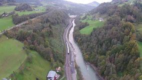 Aerial view of the Alps in Austria, mountains, river and railroad