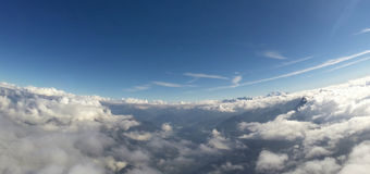 Aerial View - Alps, Clouds and Blue Sky Stock Photo