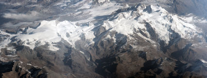 Aerial view of Alps mountains. Wide angled aerial view of snow capped Alps mountain range, Europe royalty free stock images