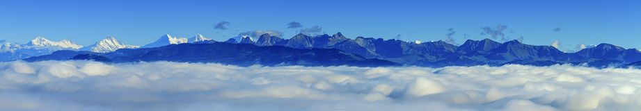 Aerial view on Alps mountains upon clouds, seen Royalty Free Stock Photo