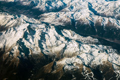 Aerial view of alps mountains covered with snow Stock Images