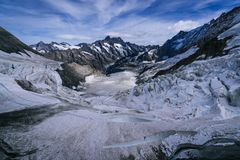 Aerial view of the Alps mountains in Switzerland. View from helicopter in Swiss Alps. Mountain tops in snow. royalty free stock photo