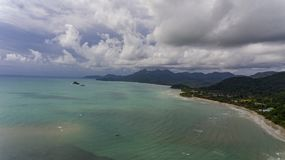 Aerial view with amazing beach and blue water. Aerial View of Koh Chang, Thailand with amazing beach, green trees and blue water. Drone picture of tropical royalty free stock photography
