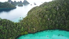 Aerial View of Amazing Islands in Wayag, Raja Ampat. Rugged limestone islands, surrounded by coral reefs, are found in an idyllic, tropical lagoon in Wayag, Raja stock video