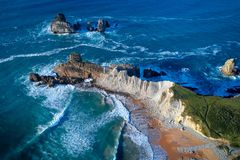 Aerial view of amazing rock formations on the Arnia beach, Spain. Aerial view of amazing rock formations on the Arnia beach, Costa Quebrada, Cantabria, Northern stock photo