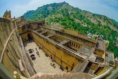 Aerial view of Amber Fort landscape with some rooftops of the building and small houses in the horizont, Amber Fort is. The main tourist attraction in the stock images