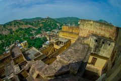Aerial view of Amber Fort landscape with some rooftops of the building and small houses in the horizont, Amber Fort is. The main tourist attraction in the stock image