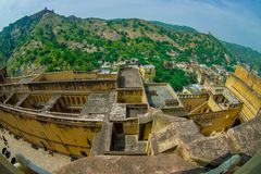 Aerial view of Amber Fort landscape with some rooftops of the building and small houses in the horizont, Amber Fort is Royalty Free Stock Images