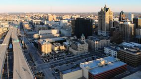 Aerial view of american city at dawn. High-rise buildings, fre. Eway, bay. Sunny morning. Milwaukee, Wisconsin, USA royalty free stock photo