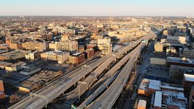 Aerial view of american city at dawn. High-rise buildings, fre. Eway, bay. Sunny morning. Milwaukee, Wisconsin, USA stock photo