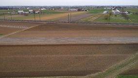Amish Farm Lands being Ready for a New Growing Season as Seen by a Drone. Aerial View of Amish Farm Lands being Ready for a New Growing Season as Seen by a Drone stock video footage