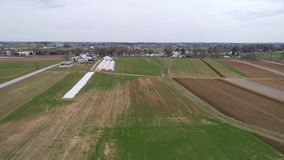 Amish Farm Lands being Ready for a New Growing Season as Seen by a Drone. Aerial View of Amish Farm Lands being Ready for a New Growing Season as Seen by a Drone stock footage