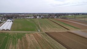 Amish farm lands being ready for a new growing season as seen by a drone. Aerial view of amish farm lands being ready for a new growing season as seen by a drone stock video