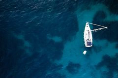 Aerial view of anchored sailing yacht stock photo