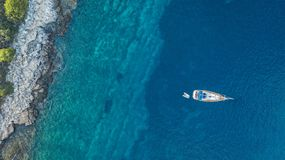 Aerial view of anchoring yacht next to the island. Ocean and sea travel and transportation Stock Photography