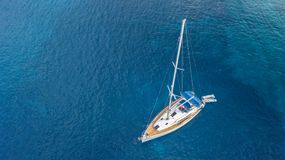 Aerial view of anchoring yacht in open water. stock images