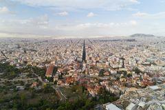 Ancient Agora of Athens and modern city. Aerial view of Ancient Agora of Athens and modern city Royalty Free Stock Photo