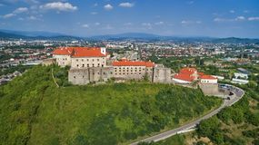 Aerial view on the ancient castle of Palanok in Mukachevo. Aerial view on the ancient castle of Palanok and the foothills of Carpathians Mountains, in Mukachevo royalty free stock photography