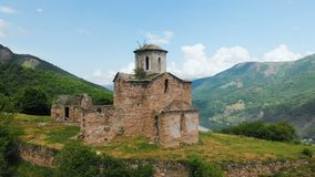 Aerial view an ancient partially destroyed Christian church of the tenth century AD in the Caucasian mountains of the. Republic of Karachay - Cherkessia stock footage