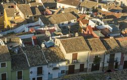 Aerial View of Ancient Spanish Rooftops. Picturesque aerial view of ancient city rooftops, Xativa Jativa, Valencia, Spain Royalty Free Stock Photography