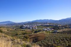 Aerial view of Andalusian countryside and the town of Alfina. A scenic spanish town of alfina in andalusia with white buildings dry grassses olive groves and Stock Image