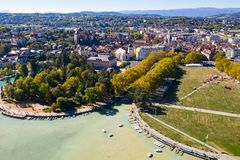 Aerial view of Annecy lake waterfront low tide level due to the royalty free stock photos