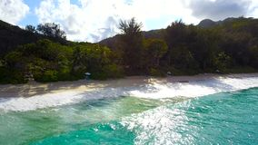 Aerial view of Anse Intendance, Seychelles. Aerial view of Anse Intendance in Mahe`, Seychelles. Panorama of an exotic beach. View of the sea surf, beach chaise stock video footage
