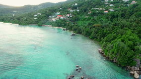 Aerial view of Anse Royale beach on Mahe Island, Seychelles Islands. The tropical paradise of Seychelles Islands from bird's perspective stock footage