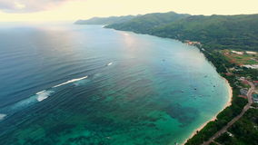 Aerial panorama of Anse Royale tropical coast on Mahe Island, Seychelles, twilight time. stock footage