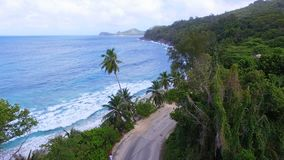 Aerial view of Anse Takamaka Bay And The Road 1, Mahe Island, Seychelles. Drone shot of Anse Takamaka Bay, Mahe Island, Seychelles stock video footage