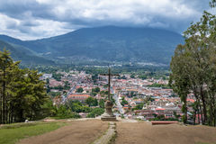 Aerial view of Antigua Guatemala city from Cerro de la Cruz with Agua Volcano in the background - Antigua, Guatemala. Aerial view of Antigua Guatemala city from Royalty Free Stock Images