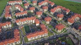 Aerial view apartment buildings complex and residential houses neighborhood. Clip. Top view of the modern luxery. Aerial view apartment buildings complex and Stock Photos