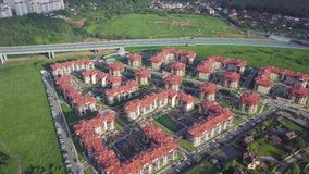 Aerial view apartment buildings complex and residential houses neighborhood. Clip. Top view of the modern luxery. Residential complex stock video