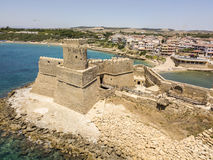 Aerial view of the Aragonese castle of Le Castella, Le Castella, Calabria, Italy. The Ionian Sea, built on a small strip of land overlooking the Costa dei Royalty Free Stock Photos