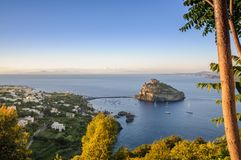 Aerial scenic view on Aragonese fortress at sunset, Ischia, Italy. Aerial view on Aragonese castle at sunset, Ischia, Italy Stock Photos